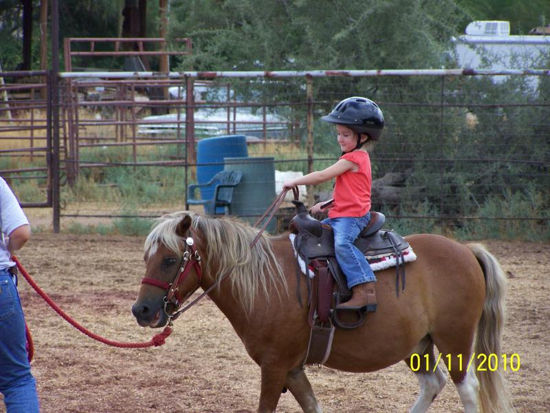 Jolie, 3 yrs. old, riding Dude